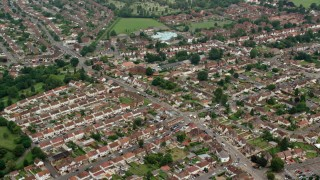 AX114_320 - 6K stock footage aerial video of orbiting a residential neighborhood, Slough England