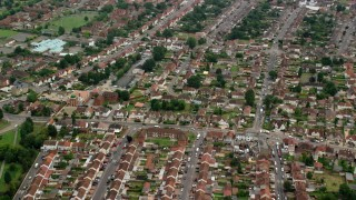 AX114_321 - 6K stock footage aerial video of orbiting a residential neighborhood and fly away, Slough, England