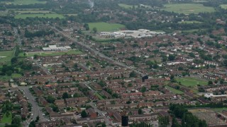 AX114_323 - 6K stock footage aerial video of orbiting row houses in a residential neighborhood, Slough, England