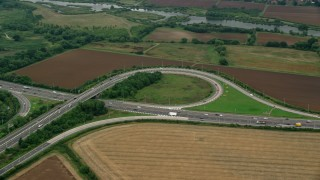 AX114_325 - 6K stock footage aerial video of an orbit of M4 Freeway Interchange by farmland, Windsor, England