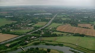AX114_326 - 6K stock footage aerial video of M4 Freeway through farmland, Maidenhead, England