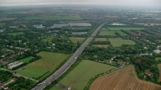 AX114_327 - 6K stock footage aerial video of M4 freeway and farmland by Bray Lake, Maidenhead, England