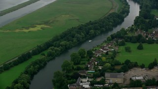 AX114_330 - 6K stock footage aerial video of orbiting homes along the River Thames, Windsor, England