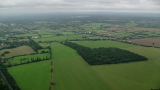 AX114_333 - 6K stock footage aerial video of flying over farm fields in Windsor, England