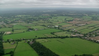 AX114_334 - 6K stock footage aerial video of flying over farms and farm fields, Windsor, England