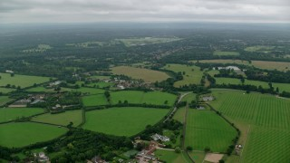 AX114_337 - 6K stock footage aerial video of farm fields and rural homes, Windsor, England