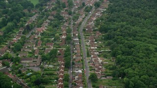 AX114_339 - 6K stock footage aerial video of residential neighborhoods among trees, Ascot, England