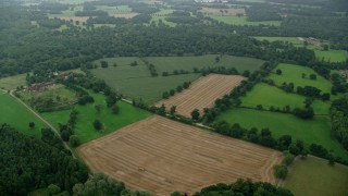 AX114_341 - 6K stock footage aerial video of orbiting an upscale home among farmland, Ascot, England
