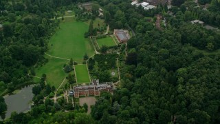 AX114_342 - 6K stock footage aerial video of upscale homes surrounded by trees, Ascot, England