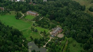 AX114_343 - 6K stock footage aerial video of an orbit of upscale homes surrounded by trees, Ascot, England
