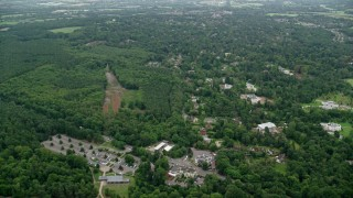 AX114_347 - 6K stock footage aerial video fly over homes in the small town of Virginia Water, England