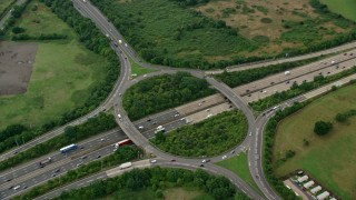AX114_354 - 6K stock footage aerial video of orbiting M25 Freeway roundabout, Chertsey, England