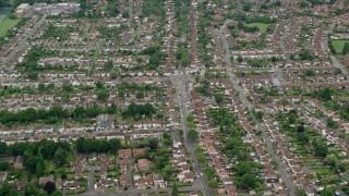 AX114_357 - 6K stock footage aerial video of orbiting residential neighborhoods, Addlestone, England