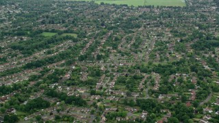 AX114_367 - 6K stock footage aerial video fly over residential neighborhoods, tilt to homes, Leatherhead, England