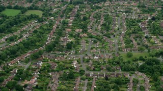 AX114_368 - 6K stock footage aerial video fly over residential neighborhoods, Leatherhead, England
