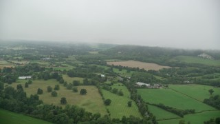 AX115_004 - 6K aerial stock footage video fly over farm fields and trees, Betchworth, England