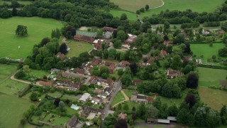 AX115_011 - 6K stock footage aerial video fly over the village of Mickleham, England