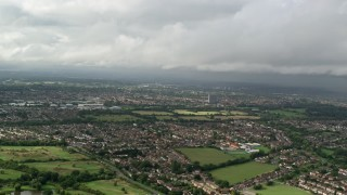 AX115_012 - 6K stock footage aerial video approach residential neighborhoods, Chessington, England