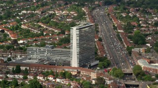 AX115_016 - 6K stock footage aerial video of flying by an office building in Tolworth, England