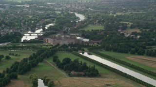 AX115_020 - 6K stock footage aerial video of orbiting Hampton Court Palace, Molesey, England