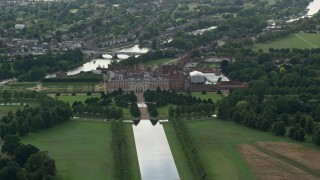 AX115_021 - 6K stock footage aerial video orbit Hampton Court Palace, Molesey, England
