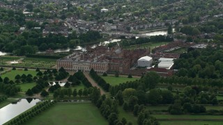 AX115_022 - 6K stock footage aerial video of an orbit of Hampton Court Palace, Molesey, England