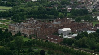 AX115_023 - 6K stock footage aerial video of orbiting historic Hampton Court Palace, Molesey, England
