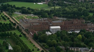 AX115_024 - 6K stock footage aerial video orbit historic Hampton Court Palace in Molesey, England