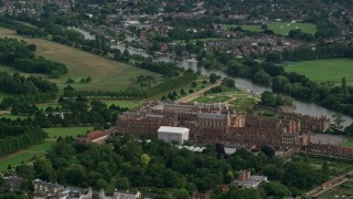AX115_025 - 6K stock footage aerial video of flying around Hampton Court Palace, Molesey, England