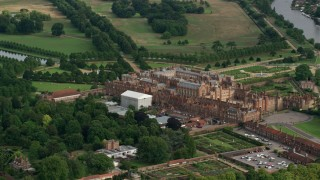 AX115_026 - 6K stock footage aerial video of circling around Hampton Court Palace, Molesey, England