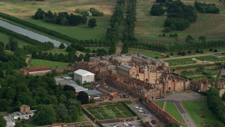 AX115_027 - 6K stock footage aerial video of circling around historic Hampton Court Palace, Molesey, England