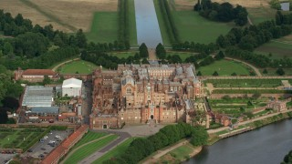 AX115_028 - 6K stock footage aerial video of historic Hampton Court Palace, Molesey, England