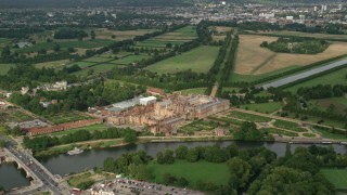 AX115_029 - 6K stock footage aerial video of orbiting Hampton Court Palace, Molesey, England