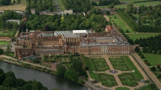 AX115_030 - 6K stock footage aerial video of an orbit of Hampton Court Palace by the River Thames, Moseley, England