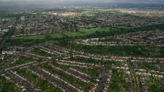 AX115_034 - 6K stock footage aerial video fly over homes in residential neighborhoods, Surbiton, England