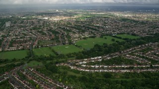 AX115_035 - 6K stock footage aerial video of suburban neighborhoods and sports fields, Surbiton and New Malden, England