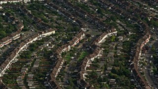 AX115_042 - 6K stock footage aerial video of rows of homes in a residential neighborhood, Morden, England