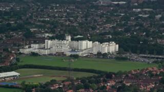 AX115_045 - 6K stock footage aerial video orbit St Helier Hospital, Carshalton, England