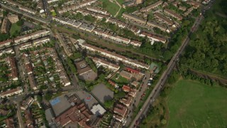 AX115_046 - 6K stock footage aerial video of a bird's eye view of suburban neighborhoods in London, England