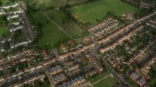 AX115_047 - 6K stock footage aerial video bird's eye view of residential neighborhoods, reveal a cemetery, London, England