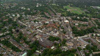 AX115_051 - 6K stock footage aerial video tilt while orbiting a residential neighborhood, London, England