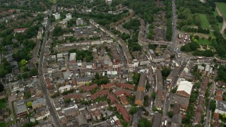 AX115_052 - 6K stock footage aerial video of flying over homes in a residential neighborhood, London, England