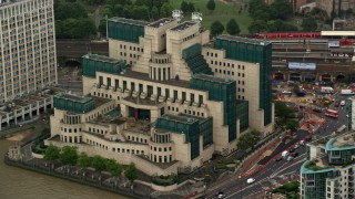 AX115_068 - 6K stock footage aerial video of an orbit of the MI6 Building in the rain, London, England