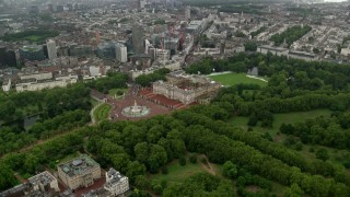 AX115_079 - 6K stock footage aerial video approach Buckingham Palace in the rain, London, England