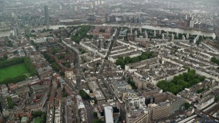 AX115_081 - 6K stock footage aerial video of orbiting apartment buildings and city streets in the rain, London, England