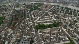 AX115_082 - 6K stock footage aerial video of orbiting streets and apartment buildings in the rain, London, England
