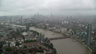 AX115_084 - 6K stock footage aerial video of the River Thames winding through the city, London, England