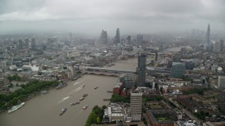 AX115_090 - 6K stock footage aerial video of Blackfriars Bridge over River Thames, Central London England