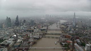 AX115_092 - 6K stock footage aerial video follow the River Thames through Central London, England