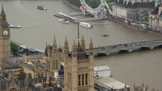 AX115_103 - 6K stock footage aerial video of British Flag atop Parliament reveal Big Ben, London England
